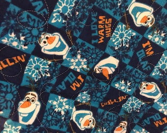 Olaf print in all cotton.the backing is a turquoise minky,and Machine quilted by me. An heirloom quality quilt.