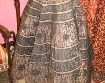 "1950's, 30"" waist, stiff brown taffeta circle skirt."