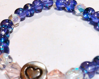 Pink purple, and white stretch braclet with silver heart, with matching earrings