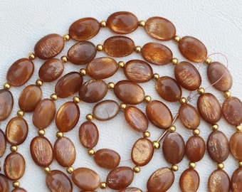 25 piece smooth golden shine oval beads 11 -- 13 mm approx