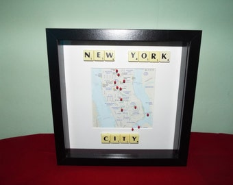 New York City Map with Must See Landmarks pinned into a Frame with Scrabble Tiles