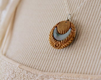 Unusual collectible antique metal glass scallop shell button pendant necklace vintage jewelry ornate sky blue luminescent victorian