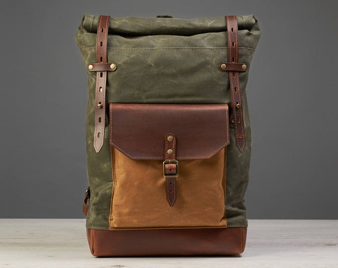 Canvas and leather laptop backpack. Deep green heavy waxed canvas.