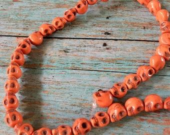 SKULL 10mm by 8mm Beads Strand Tiny Orange Howlite Stone