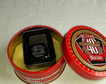 Vintage 1994 Advertising Zippo Lighter Commemorating 40 Years of Winston Cigarettes from 1954-1994. New in the box/tin. Nicely Embossed.