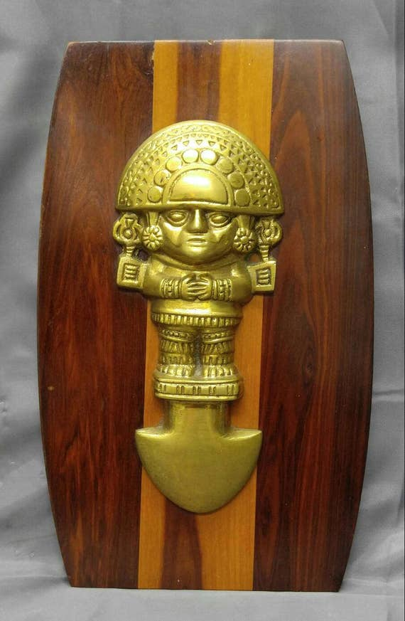 Old vintage wooden decorative wall plaque with brass Peruvian