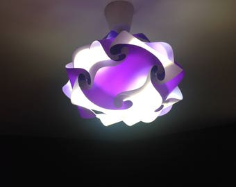 oval light purple and white lamp puzzle