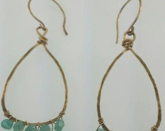 Hand forged earrings with green apatite stones