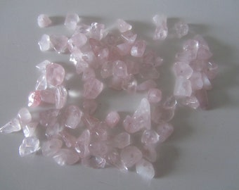 bag of 20 g of light pink coloured chips beads