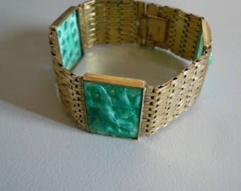 Art deco style 1950s green peking glass and gold tone metal bracelet.