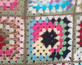 Multi coloured granny square throw. Measures 50x31inches. OOAK hand made lap blanket. English country cottage style cover. Bed runner.