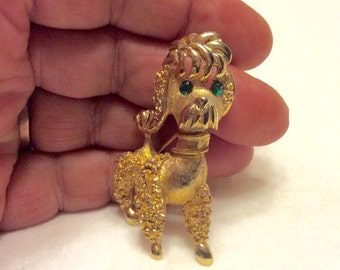 Vintage poodle brooch pin. Gold metal green rhinestones. 1960s. Free ship