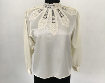 Chic lacy reverse button down blouse