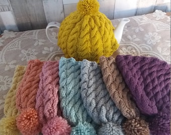 Vintage style inspired hand cable knitted tea cosy / cozy in luscious colours, with of a pompom on top! perfect afternoon tea accessory!