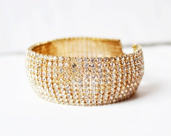 golden bracelet with white crystals