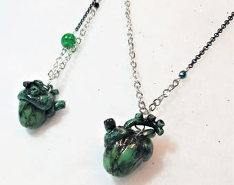 Green ripped hearts necklace