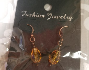 Earrings.  Dark amber crystal dangles