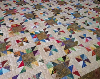 Patchwork batik and scrappy half square triangle quilt queen size 84 inches square custom quilted -