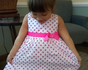 Girl's  size 3 T or 4 T pink and white polka dotted Dress one of each size