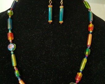 Necklace and earrings featuring colorful glass beads