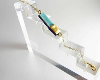 Ceramic bracelet, turquoise enamel with gold