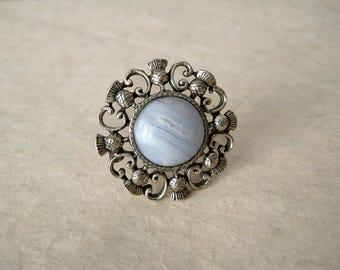 Gray banded agate brooch with silver tone decorative setting