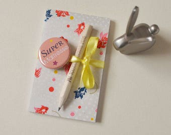 TEACHER Notepad fish badge and pencil