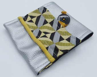 Yellow and silvery graphic checkbook cover in jacquard and faux-leather