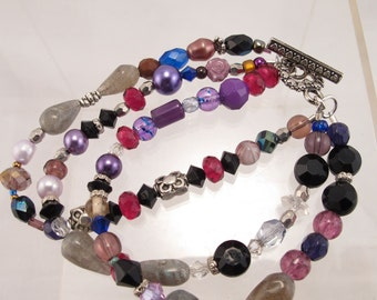 Bracelet a potpouri of color black, red,  purple and more