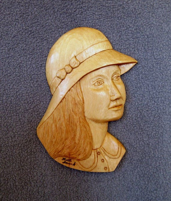 Relief woodcarving demoiselle in pine profile