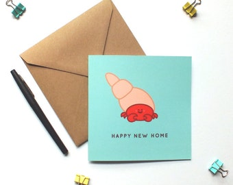 Happy new home card. Hermit crab new home card. New home card. Moving house. Congratulations new house. Greetings card.