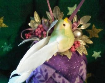 Purple glitter and purple floral print fabric pinecone ornament.