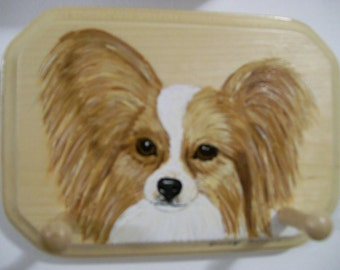 Wooden Leash/Key Holder with a Brown and White Papillon