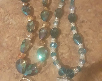 Beaded necklaces, one with the D and the other glass beads with pendants