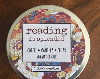 READING IS SPLENDID soy wax candle smells like a cozy reading sesh with coffee, vanilla, cedar and sandalwood notes. Travel tin, 6 oz.