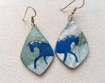 Lapis trotting horse dangle earrings.