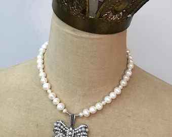 Handcrafted freshwater pearl necklace with rhinestone and pearl bow pendant