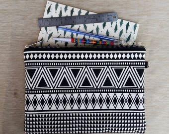 black geometric zipper pouch, cosmetics bag, pencil case, travel bag, organizer bag.