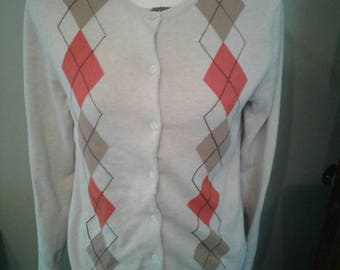 Lands End argyle cardigan.....beige with orange and gold diamonds.....ribbed bottom and cuffs...great condition.