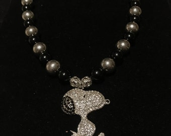 Black and silver beaded necklace with large dog embellished pendant