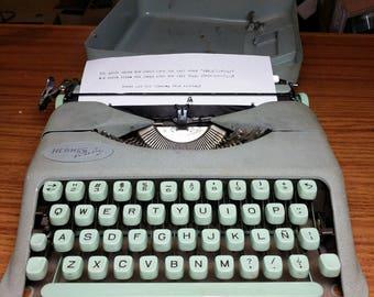 1957 Seafoam Green Hermes Baby ultra portable typewriter with Spanish keyboard