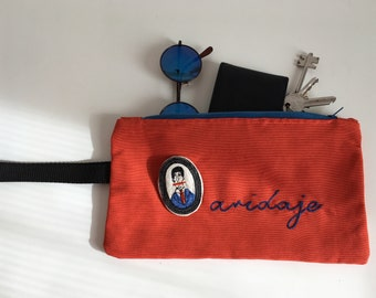 Cotton clutch bag, wristwatch, pouch