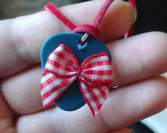 Upcycled Guitar pick and bow necklace