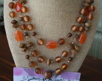 Lovely linked beaded necklace in orange and brown