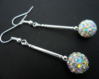 A pair of pretty white shamballa style dangly earrings.