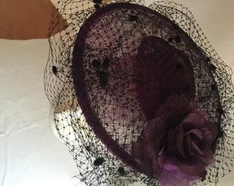 Purple fascinator with black flecked veiling