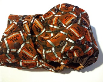 SassyCloth one size pocket diaper with football cotton print. Ready to ship.