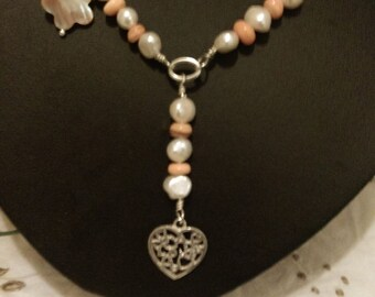 Sterling silver Necklace. 925. Freshwater pearls and mop shell. Length is 18 inches.