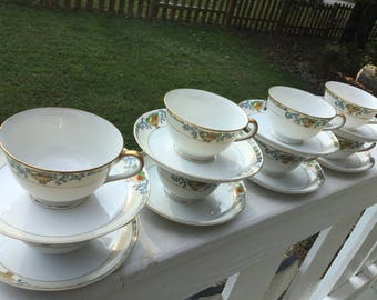 Eight Meito China Teacups.  Meito Handpainted China Teacups.  Delphi Pattern Meito China Teacups.