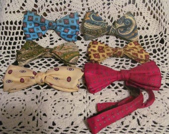 Collection of 6 bowties various materials, prints and colors.